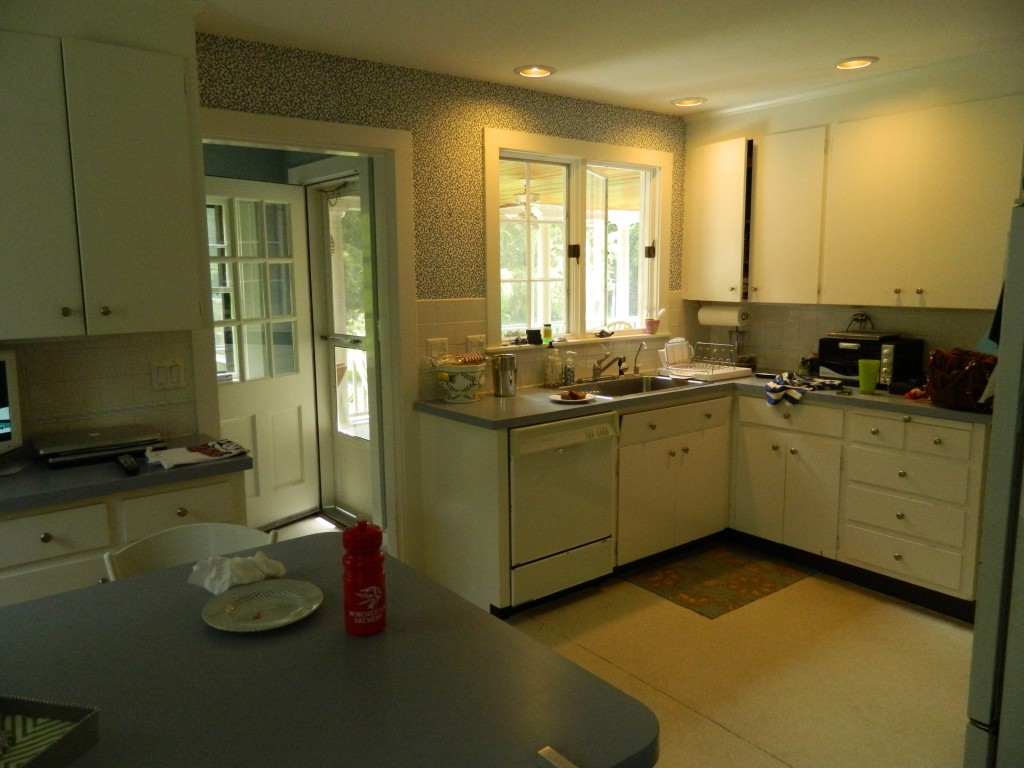 Kitchen before, awkward space usage, aging appliances